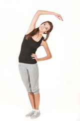 Young girl with a graceful slender figure do fitness exercises