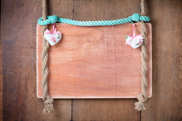 Valentine hearts, wooden frame hanging on old wooden wall