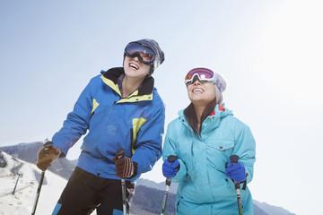 Chinese couple skiing