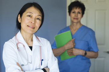 Doctor and nurse standing in office