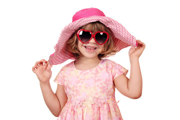 Wall Mural - happy little girl with big hat and sunglasses on white