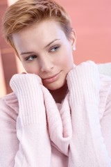 Portrait of attractive woman in pink pullover