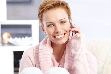 Short hair blonde woman on phone call smiling