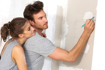 Young couple planning new home