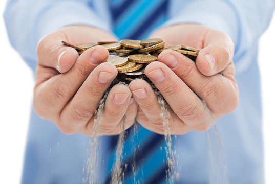 Businessman holding sand and coin