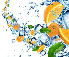 Oranges in water splash with ice cubes