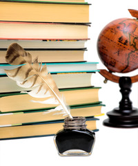 inkstand, pen, books and a globe on a white background