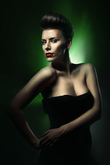 beautiful woman with red lips in dark green light
