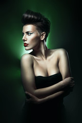 beautiful woman with red lips in green light