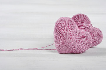 Two pink clews in shape of heart