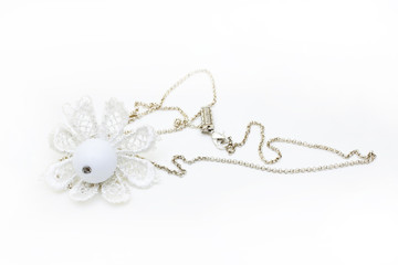 silver necklace with white flower isolated on white background