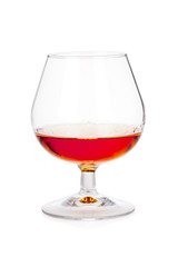 Glass of cognac or scotch on white
