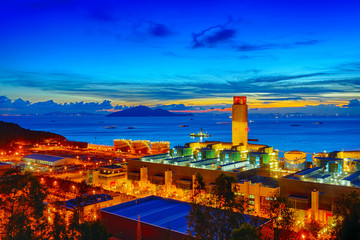 Oil and water refinery at twilight - Petrochemical factory