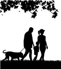 Family walking in park with dog in spring silhouette