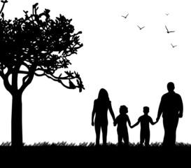Family walking in park in spring silhouette