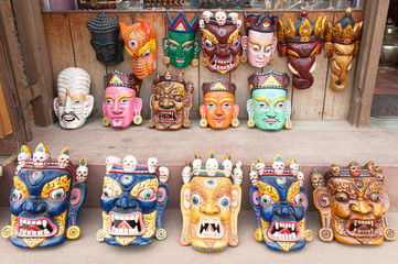 Traditional Buddhist festival masks on a shop window