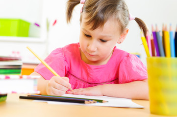 Cute little girl study at home
