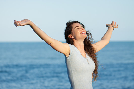 Beautiful woman with arms outstretched