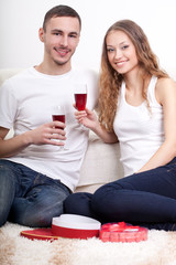 young couple  holding glasses with wine
