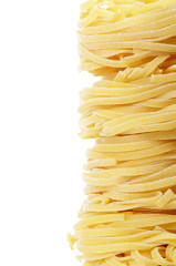 Italian pasta tagliatelle nest isolated on white background