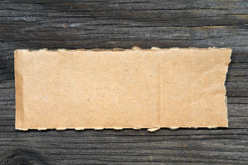 Torn piece cardboard