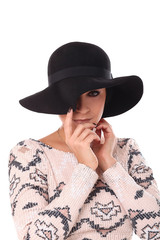Young beautiful woman in a hat