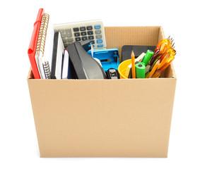 Personal belongings in cardboard box – job loss concept
