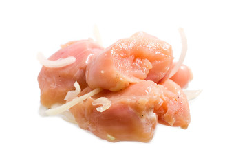 some slices of raw chicken meat on white background
