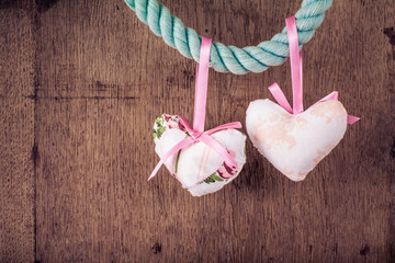 Valentine hearts in vintage style on wooden background