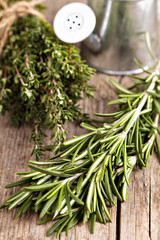 Fresh rosemary and thyme on wooden table