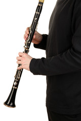 Musician playing on clarinet isolated on white