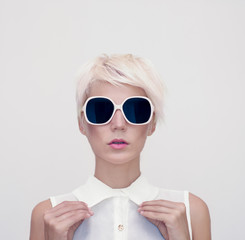 Fashion portrait of sensual girl in stylish glasses