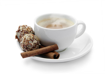 cup of coffee with chocolates and cinnamon