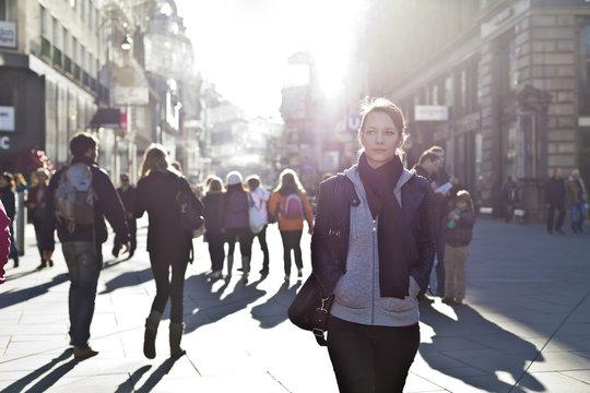 Urban girl striding through city area
