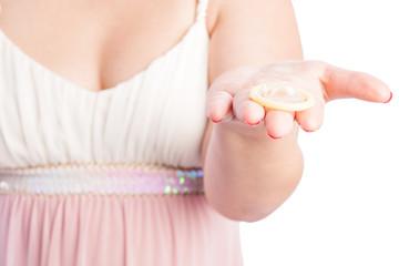 woman holding condom