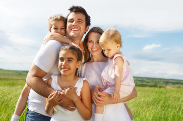 Wall Mural - Happy young family with three children