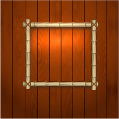 bamboo frame on a wooden wall