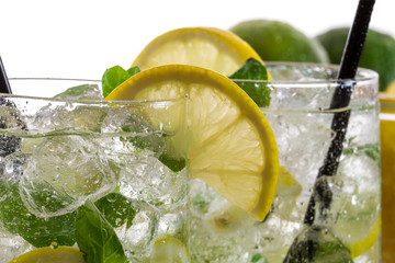 Closeup of lemon drink with ice in glass