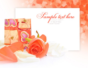 Little gift bag with rose on festive background
