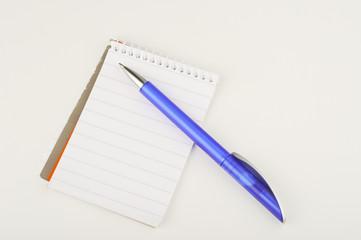 Blue pen on blank note pad