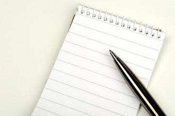 Pen on blank note pad