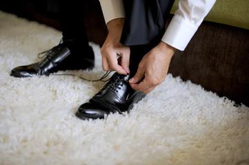 Groom Tying Shoes