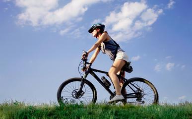 Young woman riding a bike