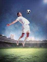 Keuken foto achterwand voetbal football player striking the ball