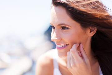 happy young woman face closeup outdoors