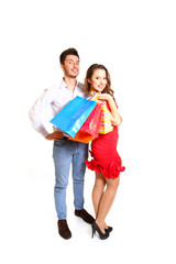 Fashion young couple with shopping bags isolated on white backgr