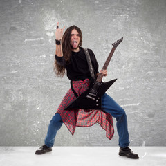rocker making a rock and roll gesture