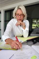 Mature woman writing