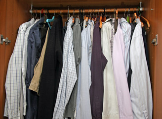 open closet with many elegant shirts for important meetings