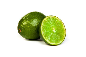 One whole lime and one half lime on white